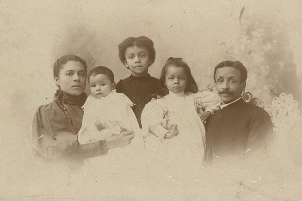 Old photo of mother, father, three young children